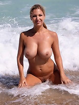 Carol gets naked and wet at the beach